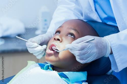 Leinwanddruck Bild Close up of boy having his teeth examined