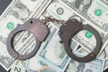 Handcuff and dollars