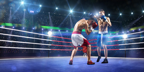Two professionl boxers are fighting on arena