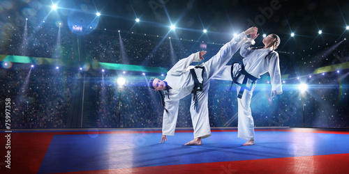 Foto op Aluminium Vechtsport Two professional female karate fighters are fighting