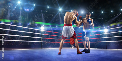 Foto op Canvas Vechtsport Two professionl boxers are fighting on arena