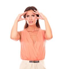 Hispanic female suffering from migraine headache