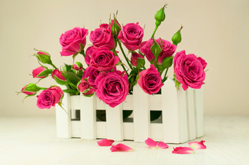 bouquet of roses in a white box