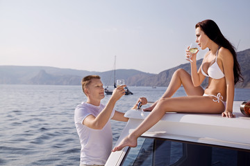 Couple celebrating their honeymoon on a yacht