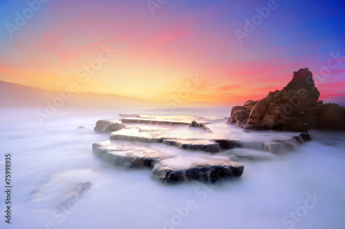 canvas print picture Azkorri beach at sunset with vivid colors