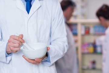 Close up of a pharmacist using mortar and pestle