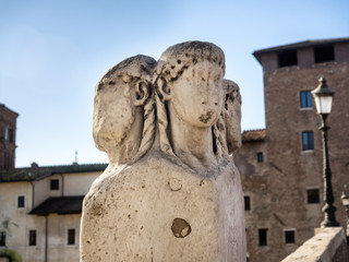 Four heads marble pillars the Ponte Fabricio Bridge in Rome