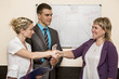 Group of young business people makes a deal