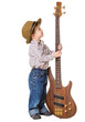 Little boy standing with rock guitar