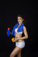 Fitness healthy girl with orange