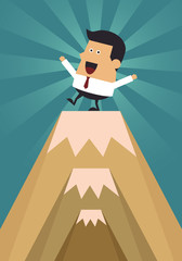 Young businessman standing on peak mountain