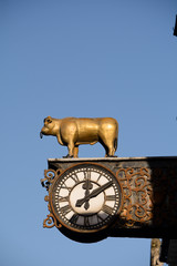 Old clock with golden bull decoration