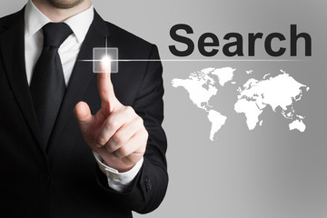 businessman pushing button search global internet