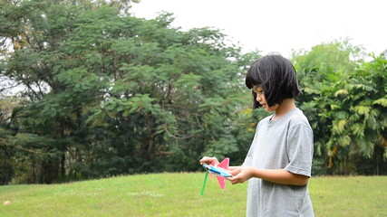 Thai young girl is playing plane in park. HD