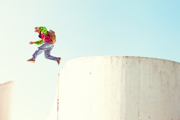 brave man jumping over the concrete wall