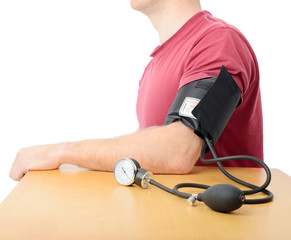 closeup of blood pressure being checked with a sphygmomanometer