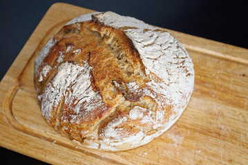 Homemade bread on the wooden plate
