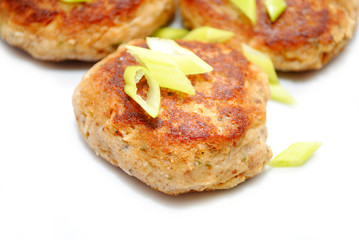 Close Up of Fish Cakes with Sliced scallions