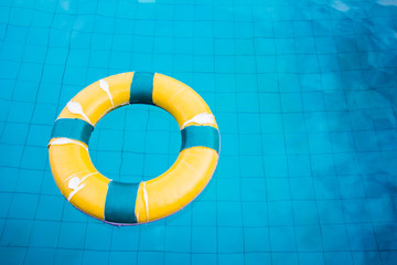 Life preserver floating in a  swimming pool