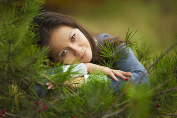 Very beautiful girl in a fir forest