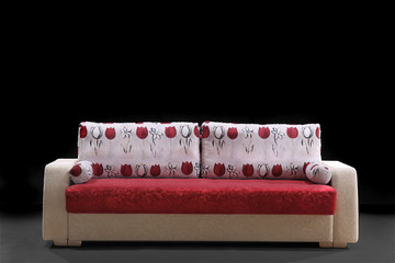White-red sofa on a black background