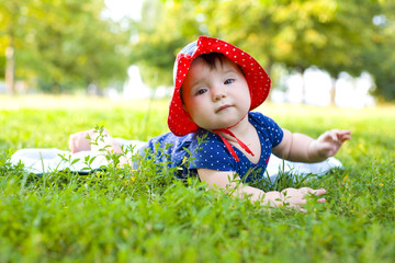 Portrait of funny little girl on the lawn