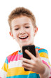 Smiling child boy holding mobile phone or smartphone taking self