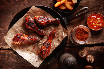 Saucy Barbecued Chicken Drumsticks on Iron Pan