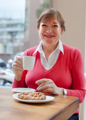 woman  in   cafe with   cup of coffee