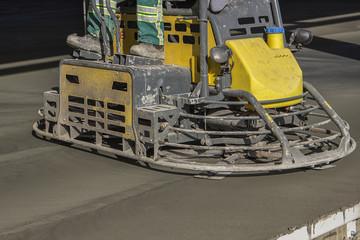 Double power trowel finishing concrete floor