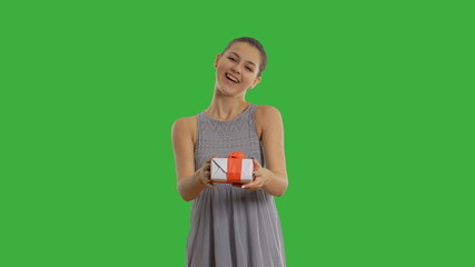 charming happy  girl presents a gift