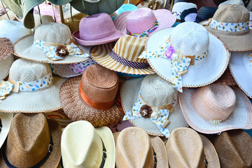 A pile of different handmade hats