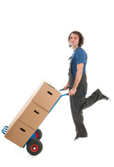 Man jumping with hand truck and boxes