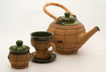 Tea pot, cup and sugar bowl