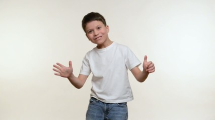 Boy grimacing and have fun. White background