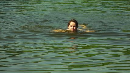 Beautiful girl bathing in the lake. 4K.