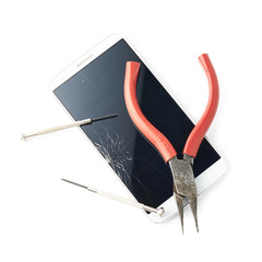 Pliers and screwdriver over the broken phone