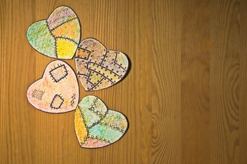 colored paper hearts on  wooden table