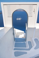 Narrow staircase with arch and seaview in Oia, Santorini