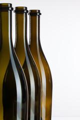 Empty bottles of wine on a glass desk