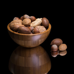 Nuts in wooden bowl.