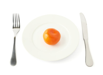 Orange fruit in a plate isolated