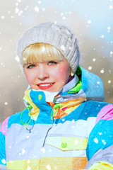 woman in ski suit, winter landscape