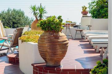 Traditional Greek vase on terrace of Santorini island
