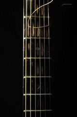 Acoustic 6 string guitar fretboard isolated on the black
