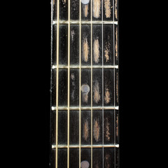 Acoustic guitar fretboard isolated on the black background