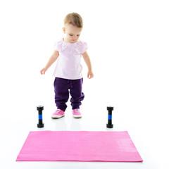Little fitness girl, studio shot over white background
