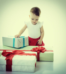 Holidays, baby girl with presents, christmas, birthday, new year