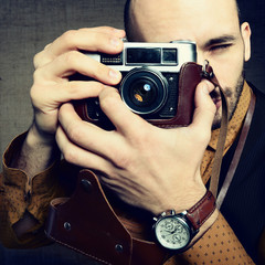 Photographer. Portrait of handsome stylish man in trendy clother
