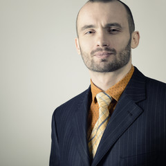 Portrait of handsome stylish man in trendy clothers, toned